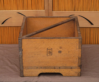 Side view - Wood rice measure, heavy iron handle,  calligraphy, Japanese mingei, for interior design, Japanese garden, tea ceremony