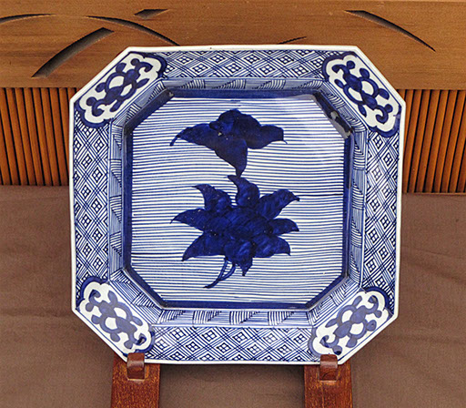 "#4180  Square blue-white porcelain plate, 45 degree corners, 11.5"" x 11.5"" x 1.5""h. Heavy  construction. Very dark blue flower center, C.1900"
