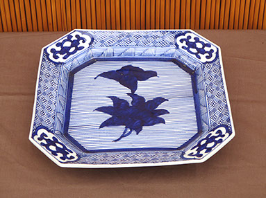 "Top view - #4180  Square blue-white porcelain plate, 45 degree corners, 11.5"" x 1.5""h. Heavy construction. Very dark blue flower center, C.1900"